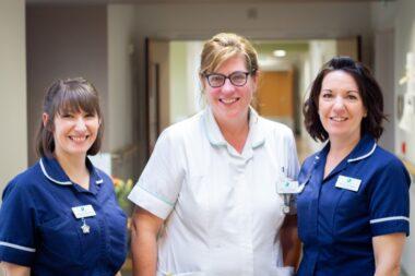 Three nurses smiling on IPU